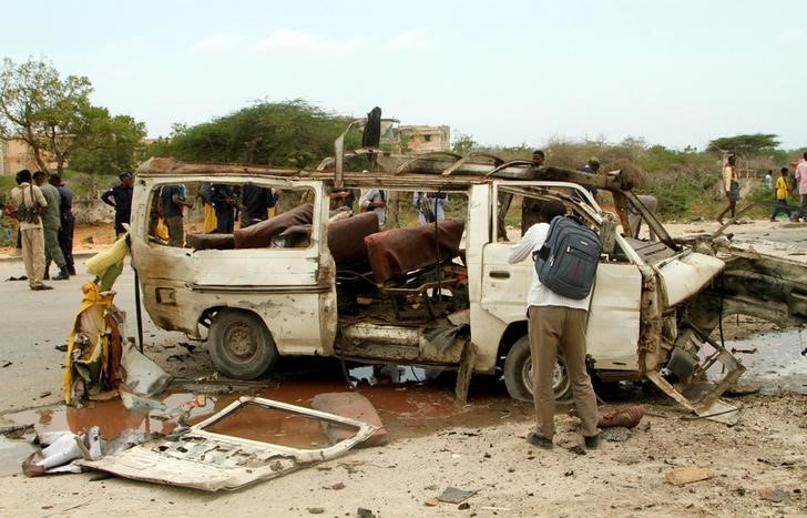 The wreckage of a minibus is seen at the scene of an explosion near a military base in Somalia's capital Mogadishu, April 9, 2017. Credit: REUTERS/Stringer