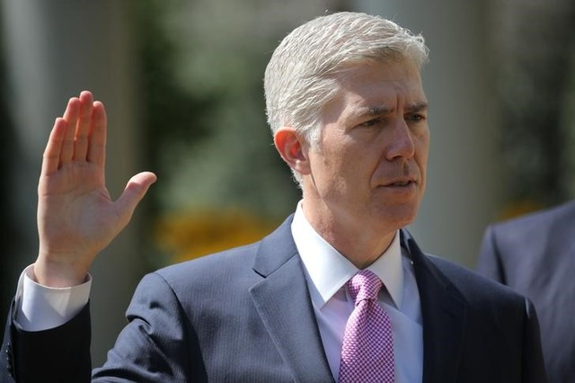 Judge Neil Gorsuch is sworn in as an associate justice of the Supreme Court in the Rose Garden of the White House in Washington, US, April 10, 2017. Credit: Reuters/Carlos Barria