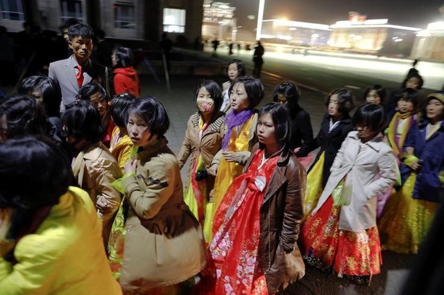 Women dressed in traditional costumes walk near the main Kim Il Sung square in central Pyongyang, North Korea April 11, 2017. Credit: Reuters/Damir Sagolj