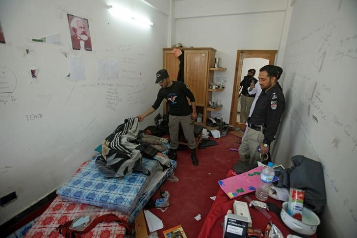 Police search the dorm room of Mashal Khan, accused of blasphemy, who was killed by a mob at Abdul Wali Khan University in Mardan, Pakistan April 14, 2017. Credit: Reuters/Fayaz Aziz