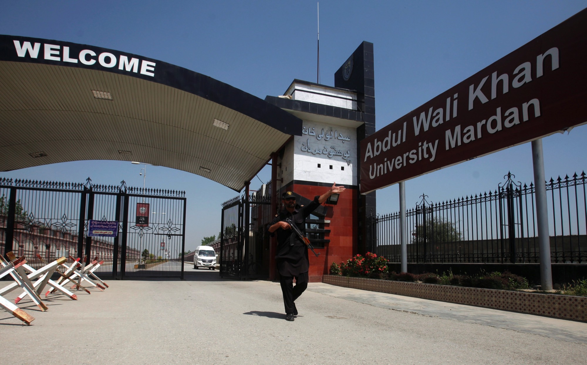 A policeman gestures as he stands guard at the entry of Abdul Wali Khan University where Mashal Khan, accused of blasphemy, was killed by a mob, in Mardan, Pakistan April 14, 2017. Credit: Reuters/Fayaz Aziz