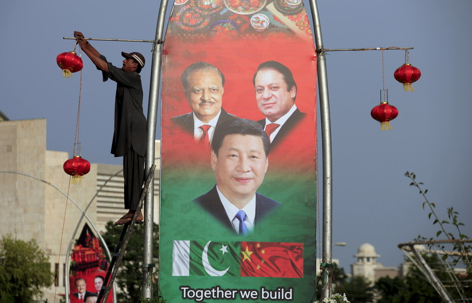 A 2015 poster in Islamabad shows Pakistan's President Mamnoon Hussain (L), China's President Xi Jinping © and Pakistan's Prime Minister Nawaz Sharif. Credit: Faisal Mahmood/Reuters