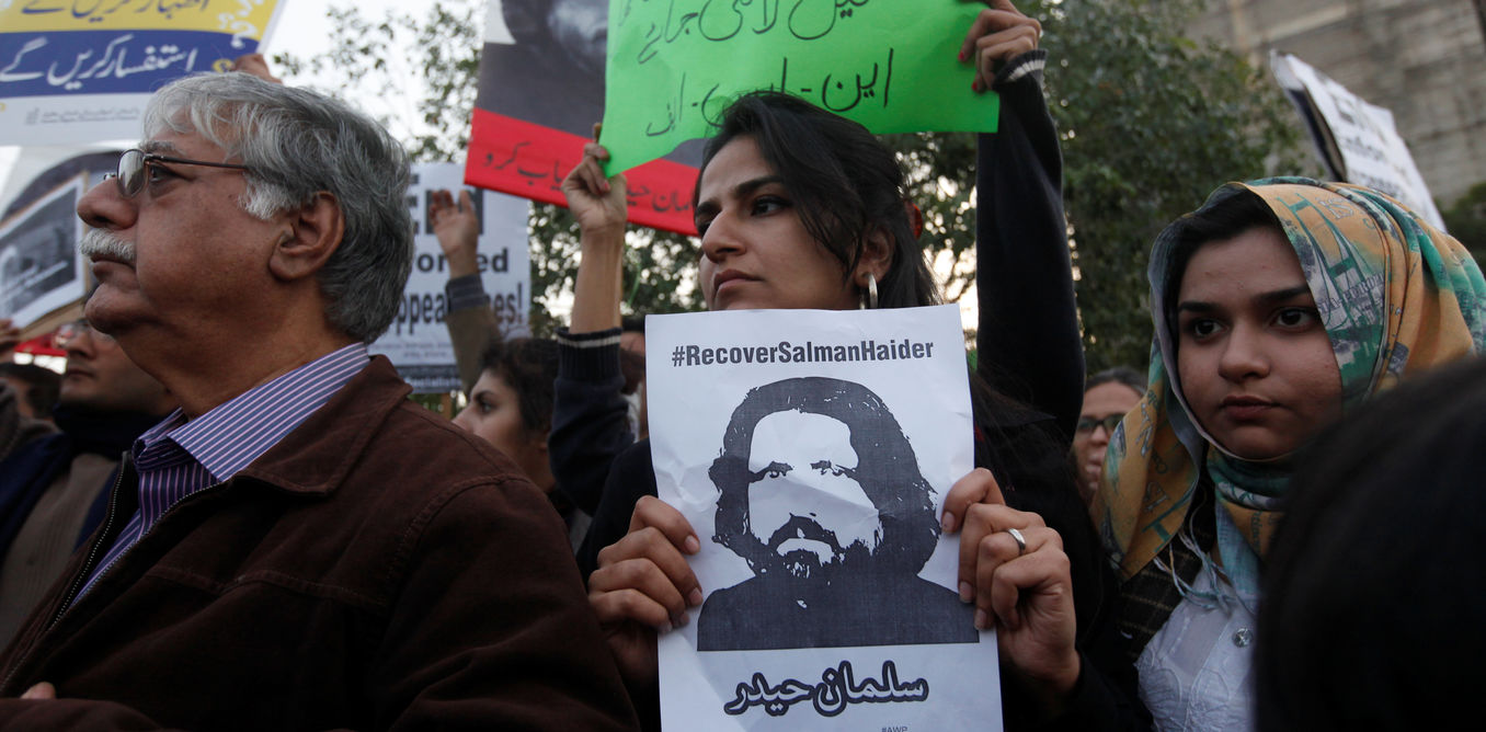 Human rights activists hold a picture of Salman Haider, who is missing, during a protest to condemn the disappearances of social activists in Karachi, Pakistan January 19, 2017. Credit: Reuters/Akhtar Soomro