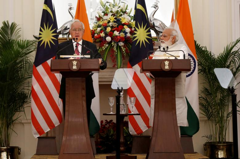 Malaysia's Prime Minister Najib Razak (L) reads a joint statement as his Indian counterpart Narendra Modi watches at Hyderabad House in New Delhi, April 1, 2017. Credit: Adnan Abidi/Reuters