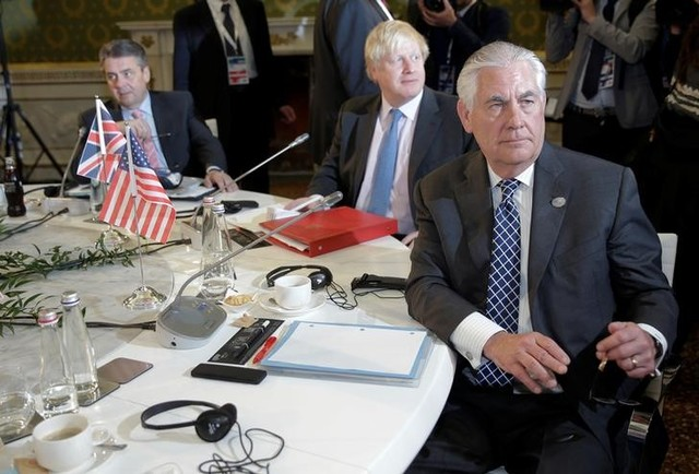 US Secretary of State Rex Tillerson (R), Britain's foreign secretary Boris Johnson (C), and German foreign minister Sigmar Gabriel attend roundtable talks during a G7 for foreign ministers in Lucca, Italy April 11, 2017. Credit: Reuters/Max Rossi