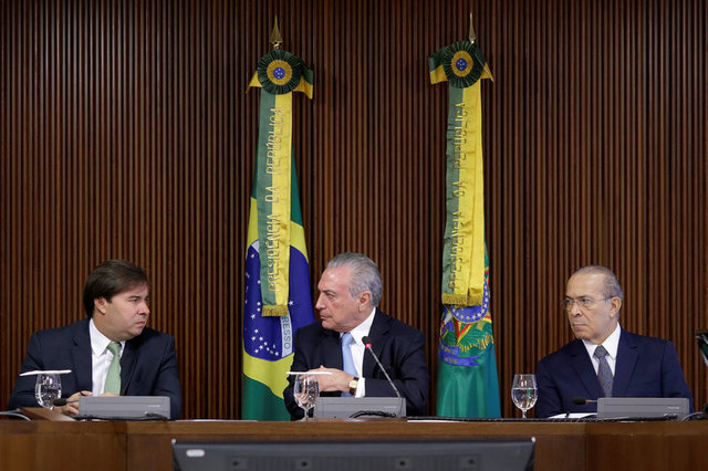 President of the Chamber of Deputies Rodrigo Maia (L) speaks with Brazil's President Michel Temer near Brazil's Chief of Staff minister Eliseu Padilha (R) during a meeting of the Pension Reform Commission at the Planalto Palace in Brasilia, Brazil, April 11, 2017. Credit: Reuters/Ueslei Marcelino