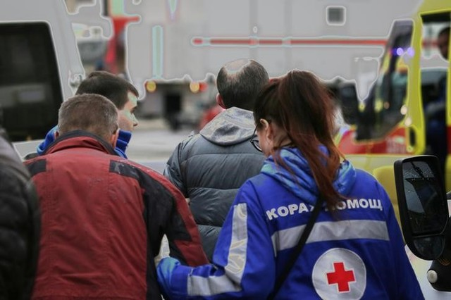 An injured person is helped by emergency services outside Sennaya Ploshchad metro station, following explosions in two train carriages at metro stations in St. Petersburg, Russia April 3, 2017. Credit: Reuters