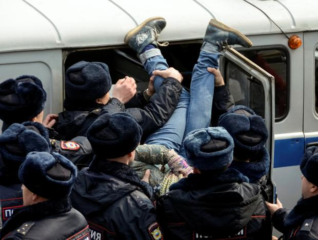 Police officers detain an opposition supporter during a rally in Vladivostok, Russia. Credit: Reuters/Yuri Maltsev