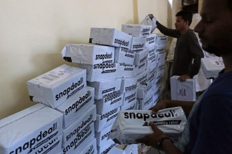 Employees of Snapdeal, an Indian online retailer, sort out delivery packages inside their company fulfilment centre in Mumbai October 22, 2014. Credit: Reuters