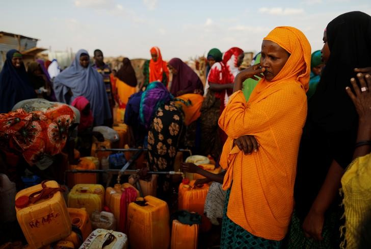 Displaced women from drought hit areas wait to fill their jerrycans as they gather at the water point at a camp for internally displaced people in Dollow, Somalia April 3, 2017. Credit: REUTERS/Zohra Bensemra