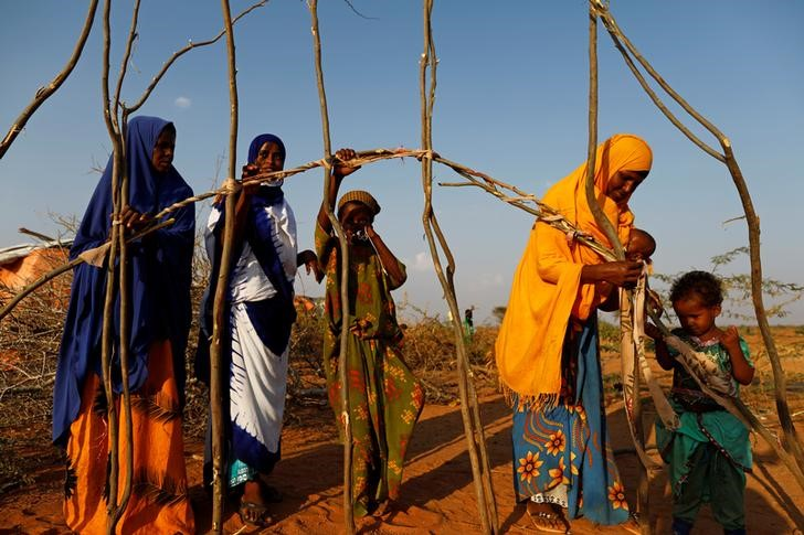 Zeinab (2nd L), 14, helps her mother Abdir (L) and her sisters Farhiya and Habiba (R) to build a new shelter at a camp for internally displaced people from drought hit areas in Dollow, Somalia April 2, 2017. Credit: Reuters/ Zohra Bensemra