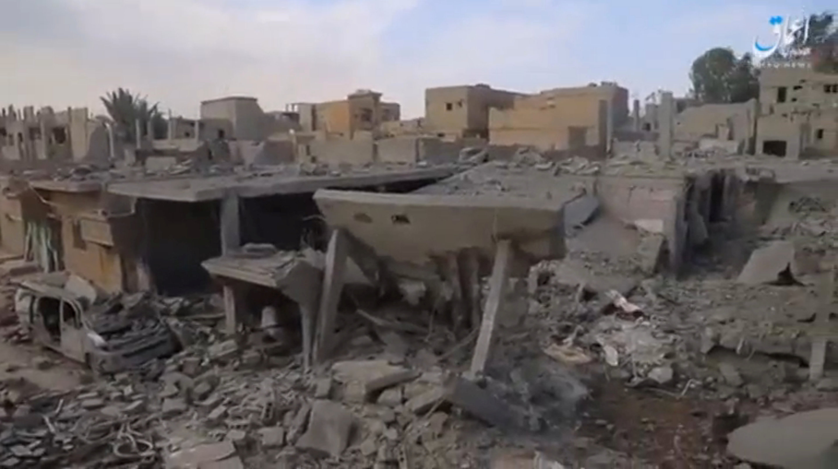 A still image taken from a video released on the internet by ISIS-affiliated Amaq News Agency, on April 18, 2017, purports to show the aftermath, said to be in al-Bukamal town, in Deir al-Zor province, after air strikes thought to have been directed by planes from a US-led military coalition, Syria. Credit: Social Media Website via Reuters TV