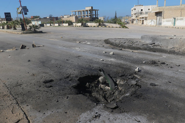 A crater is seen at the site of an airstrike, after what rescue workers described as a suspected gas attack in the town of Khan Sheikhoun in rebel-held Idlib, Syria April 4, 2017. Credit: Reuters