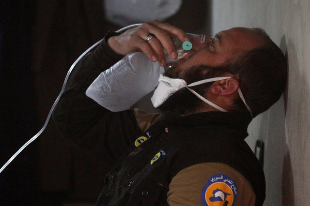 A civil defence member breathes through an oxygen mask, after what rescue workers described as a suspected gas attack in the town of Khan Sheikhoun in rebel-held Idlib, Syria April 4, 2017. Credit: Reuters
