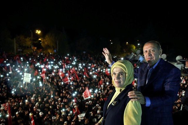 Turkish President Tayyip Erdogan, accompanied by his wife Emine Erdogan, addresses his supporters in Istanbul, Turkey, late April 16, 2017. Credit: Reuters/Yasin Bulbul/Presidential Palace