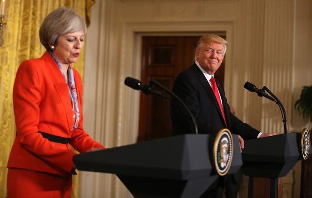 British Prime Minister Theresa May speaks as US President Donald Trump looks on during their joint news conference at the White House in Washington, US, January 27, 2017. Credit: Reuters/Carlos Barria