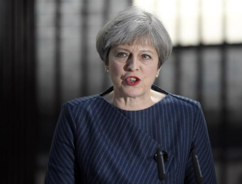 Britain's Prime Minister Theresa May speaks to the media outside 10 Downing Street, in central London, Britain April 18, 2017. Credit: Reuters/Toby Melville