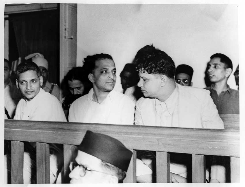 The trial of persons accused of participation and complicity in Mahatma Gandhi's assassination opened in the Special Court in Red Fort Delhi on May 27, 1948. A Close up of the accused persons. Left to right front row: Nathuram Vinayak Godse, Narayan Dattatraya Apte and Vishnu Ramkrishna Karkar. Seated behind are (from left to right) Diganber Ram Chandra Badge, Shankar s/o Kistayya, Vinayak Damodar Savarkar, Gopal Vinayak Godse and Dattatrays Sadashiv Parachure. Credit: Wikimedia Commons.