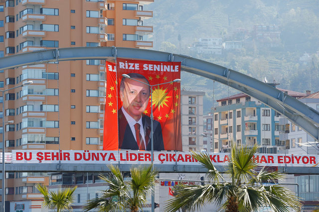 "A huge portrait of Turkish President Tayyip Erdogan is seen above a banner that reads, ""This city is proud of raising a world leader"" in Rize on the Black Sea coast, Turkey, April 5, 2017. Letters on the portrait read ""Rize is with you"". Picture taken April 5, 2017. Credit: Reuters/Umit Bektas"