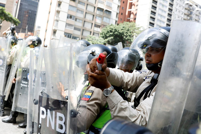 Security forces block a street using riot shields and pepper spray during an opposition rally in Caracas, Venezuela April 4, 2017. Credit: Reuters