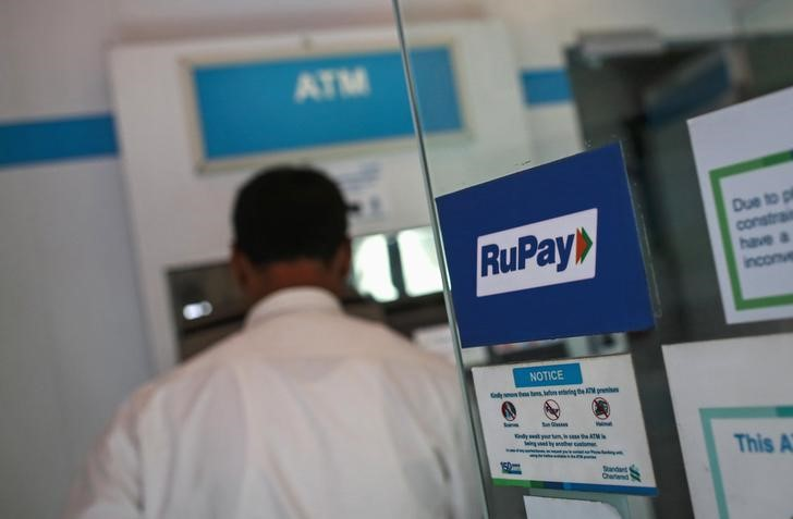 A RuPay sign is seen on the door of an ATM in Mumbai September 11, 2014. Credit: Reuters/Danish Siddiqui