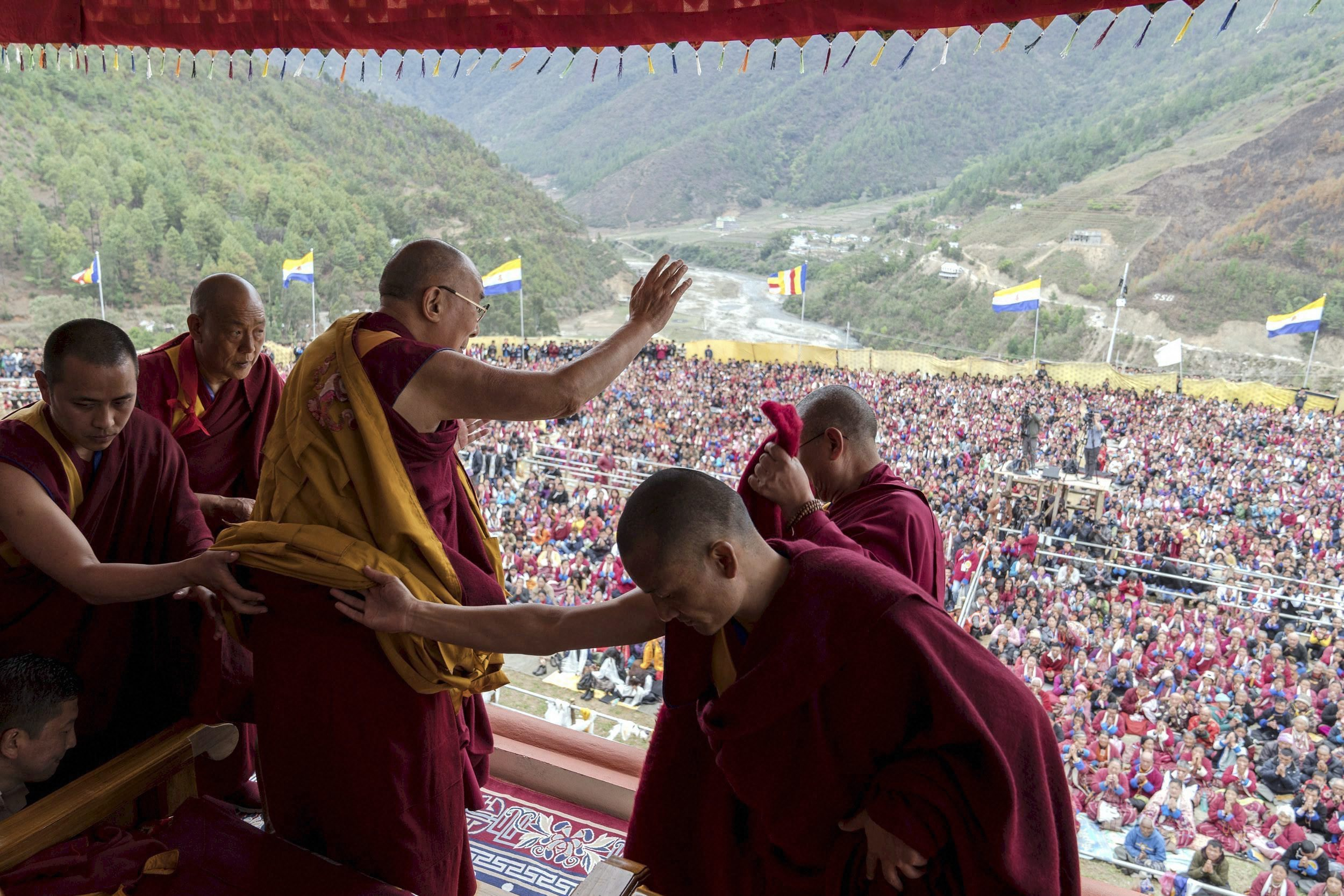 Tibetan spiritual leader Dalai Lama waves to supporters after consecrating the Thupsung Dhargyeling Monastery in Dirang, Arunachal Pradesh, on Thursday. Credit: PTI