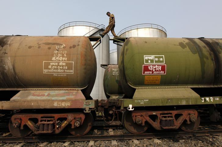 A worker walks atop a tanker wagon to check the freight level at an oil terminal on the outskirts of Kolkata November 27, 2013. REUTERS/Rupak De Chowdhuri/File Photo