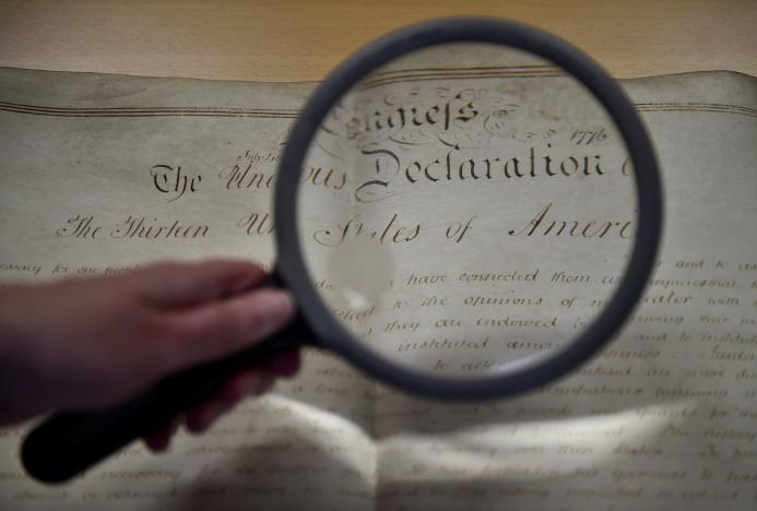 A rare handwritten copy of the US Declaration of Independence is seen at the West Sussex Record Office in Chichester in south England, Britain, April 27, 2017. Credit: Reuters/Hannah McKay