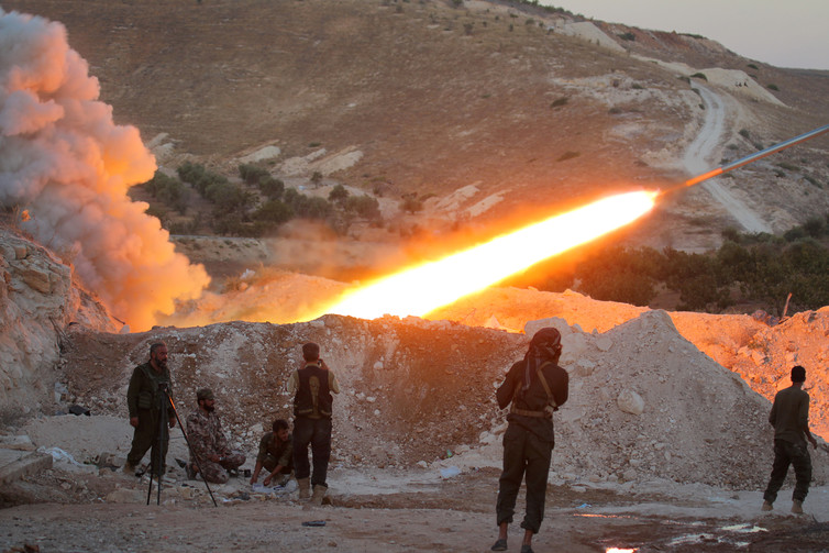Free Syrian Army fighters launch a Grad rocket from Halfaya town, in Hama province. Credit: Ammar Abdullah/Reuters