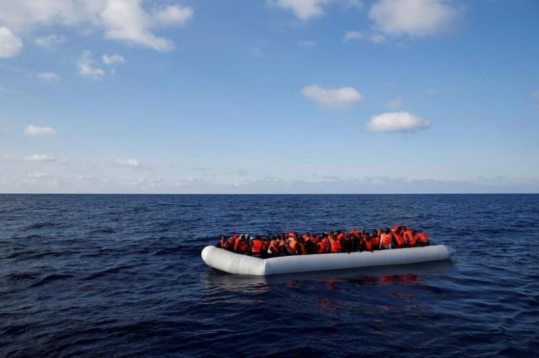 Migrants in a dinghy await rescue by the Migrant Offshore Aid Station, around 20 nautical miles off the coast of Libya, June 23, 2016. Credit: Reuters