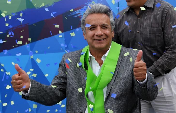 Ecuadorean leftist Lenin Moreno celebrates after the country's electoral council said he won Sunday's presidential election, at his party headquarters in Quito, Ecuador April 4, 2017. REUTERS/Mariana Bazo