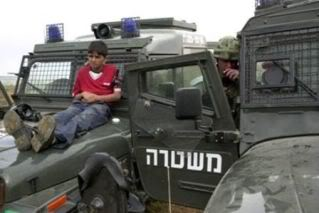 Palestinian boy strapped to an Israeli army jeep. Credit: BBC