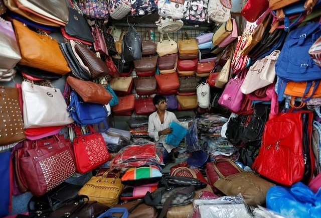 A vendor arranges bags as he waits for customers at his shop at a market in Mumbai, India, January 6, 2017. Credit: Reuters/Danish Siddiqui/File Photo