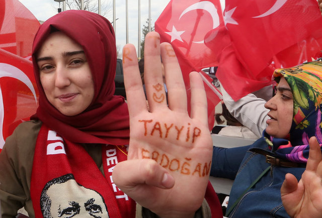 "A woman shows her hand, which reads ""Tayyip Erdogan"", as she waits for the arrival of Turkish President Tayyip Erdogan at Esenboga Airport in Ankara, Turkey, April 17, 2017. Credit: Reuters/Stringer"