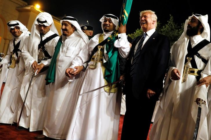 US President Donald Trump dances with a sword as he arrives to a welcome ceremony by Saudi Arabia's King Salman bin Abdulaziz Al Saud at Al Murabba Palace in Riyadh, Saudi Arabia May 20, 2017. Credit: Reuters/Jonathan Ernst