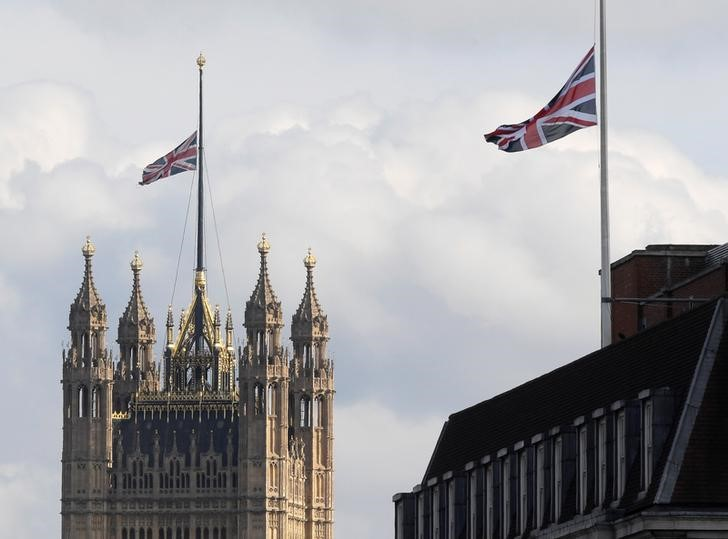 Union flags fly at half mast over Parliament and Whitehall in memory of the victims of the atack on Manchester Arena, in London, Britain, May 23, 2017. Credit: Reuters/Toby Melville