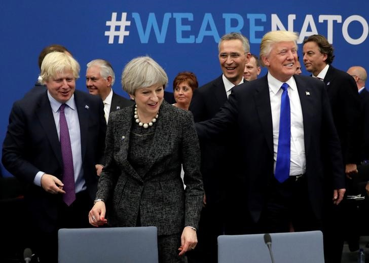 Trump Muscles His Way to the Front in NATO Summit
