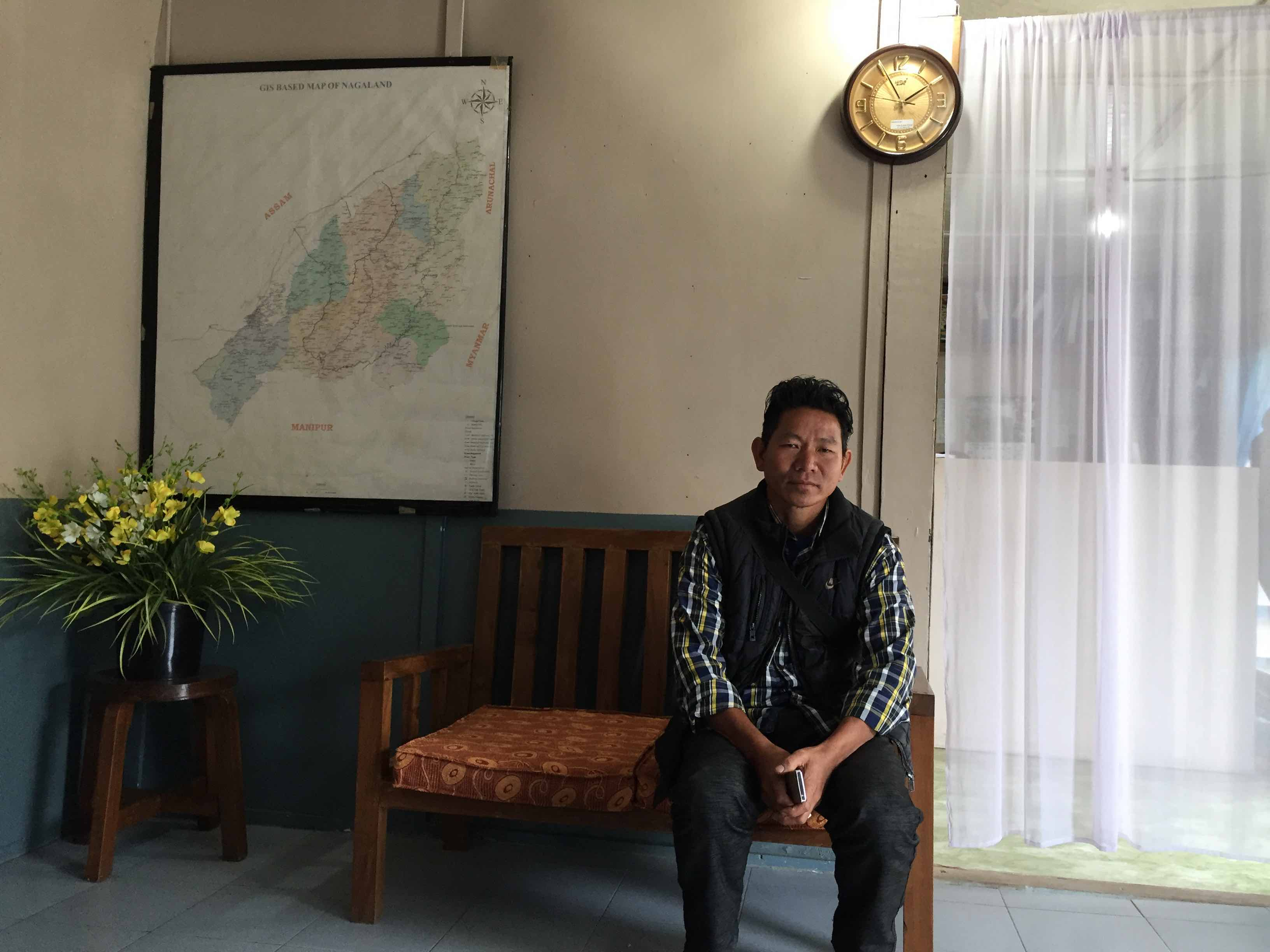 Nokying Chang in the office of the NGO Eleutheros Christian Society while he was in Tuensang to visit his daughters. Credit: Sarita Santoshini