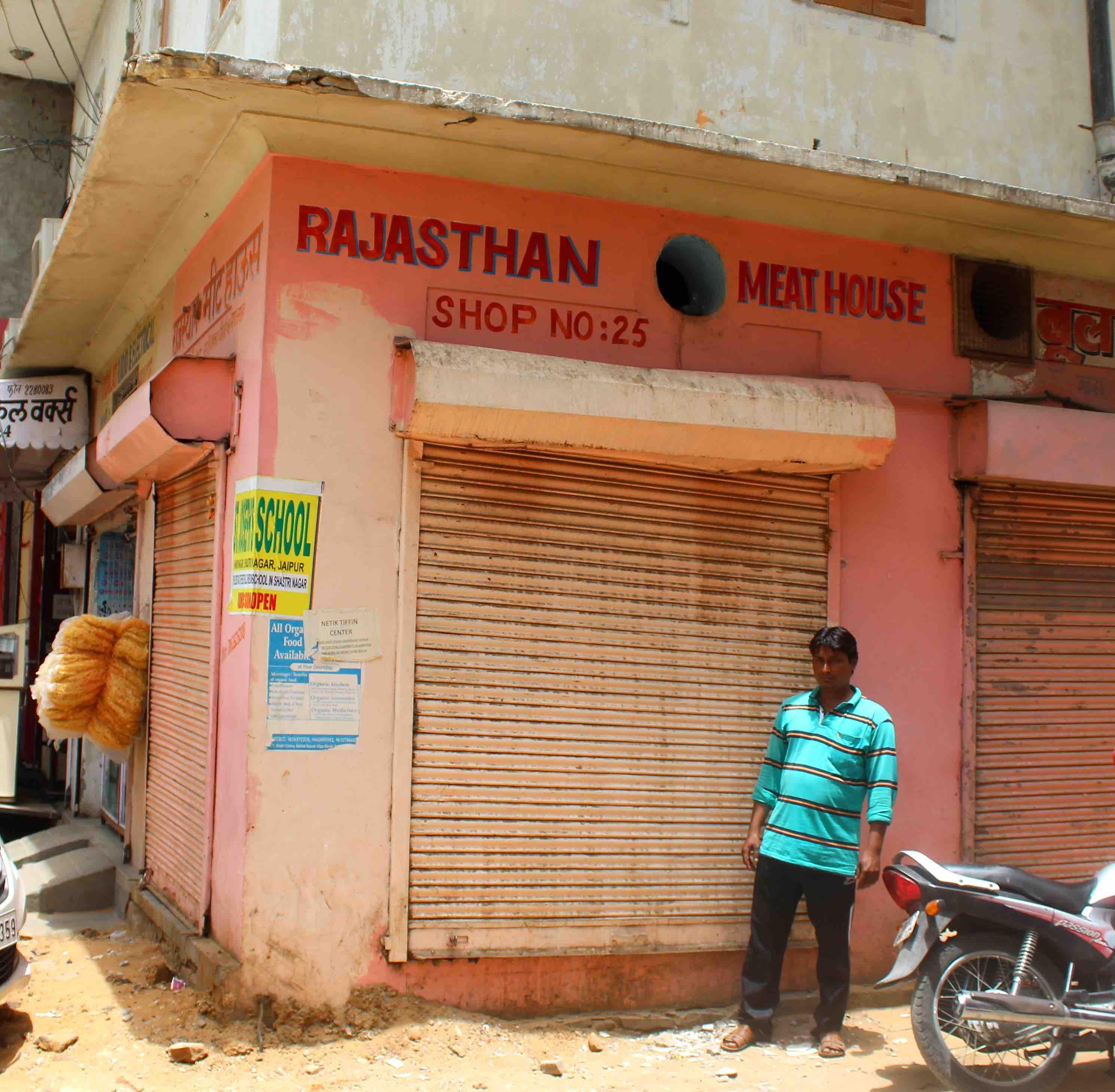 Riyazuddin Qureshi outside his sealed meat shop in Sindhi colony. Credit: Shruti Jain