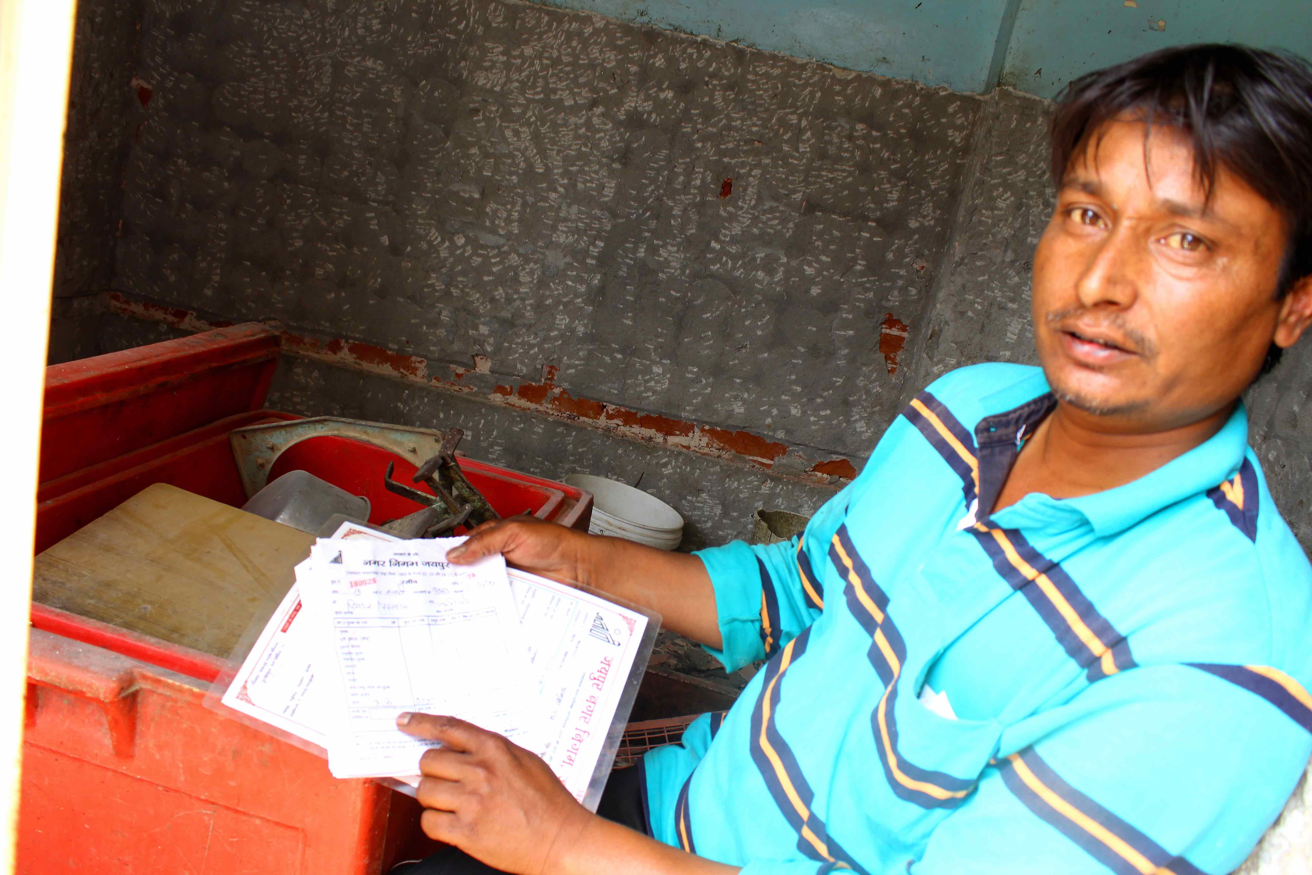 Riyazuddin Qureshi showing his licence and daily slips from the legal slaughterhouse. Credit: Shruti Jain