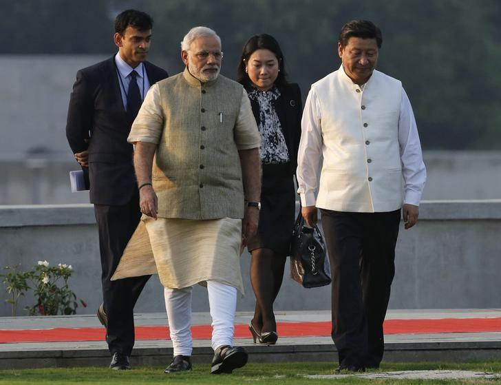 China's President Xi Jinping (R) walks with Prime Minister Narendra Modi (2nd L). Credit: Reuters/Amit Dave/Files