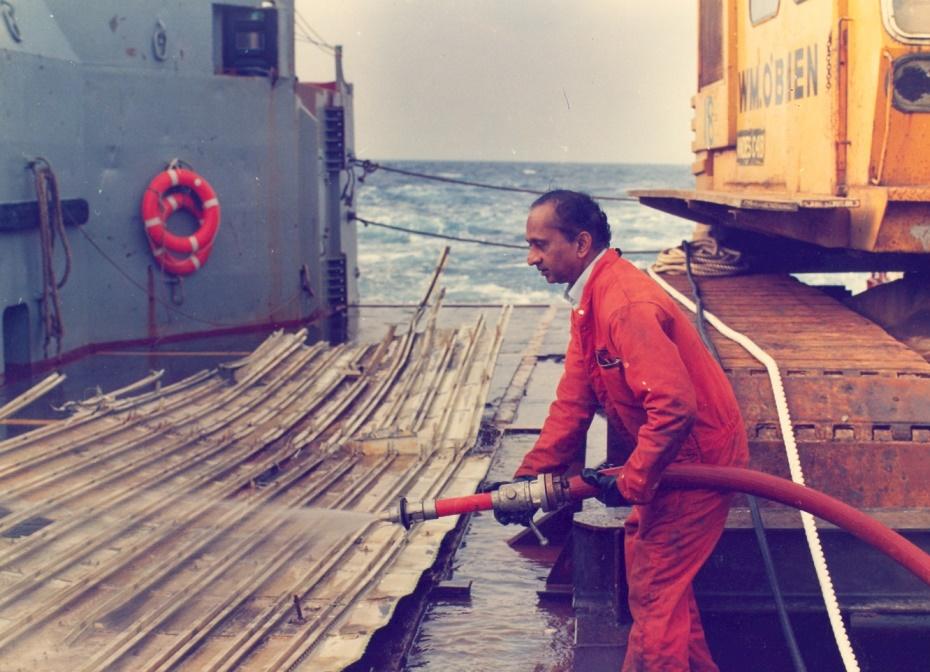 Ramachandran washing away chunks of salt from retrieved wreckage. Credit: V. Ramachandran