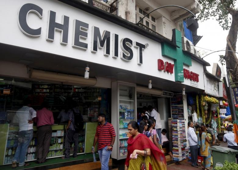 People walk past a chemist shop at a market in Mumbai, India, June 25, 2015. Credit: Reuters/Shailesh Andrade