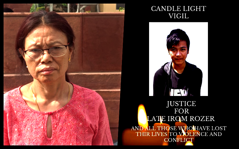 Irom Chitra and the poster of a candlelight vigil to be held for Irom Roger. Credit: Sangeeta Barooah Pisharoty/Special arrangement