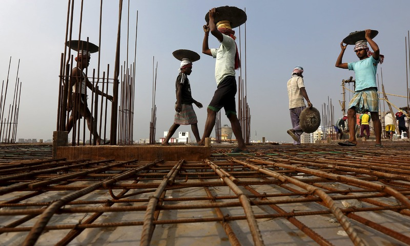 Workers at a construction site on the outskirts of Kolkata. Credit: Reuters/Files