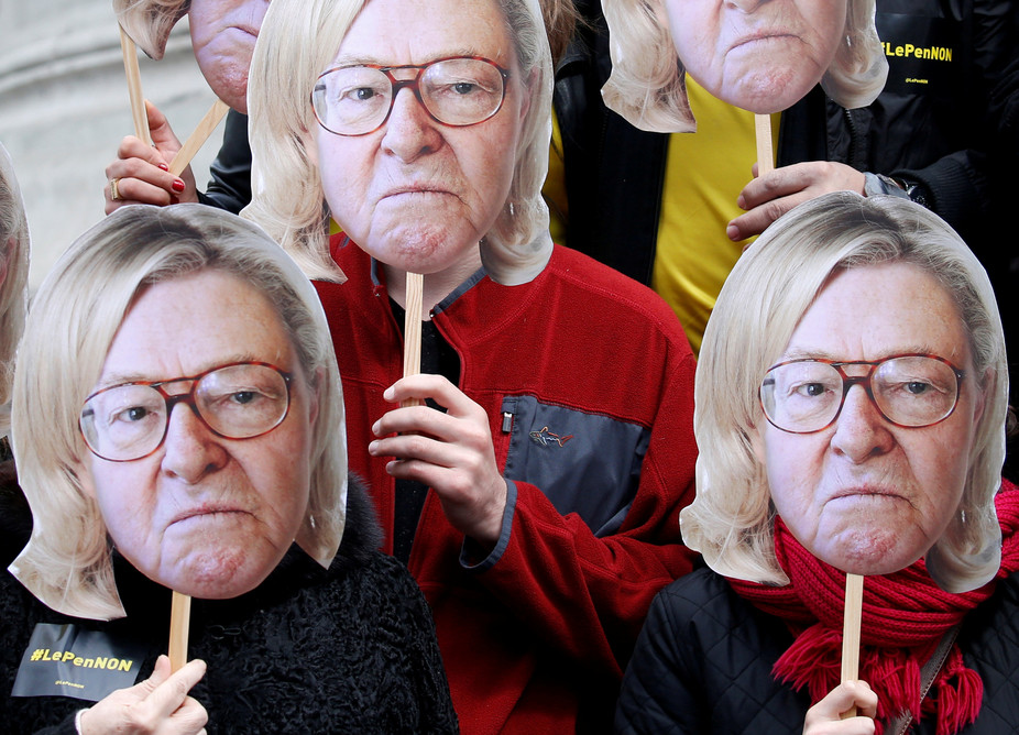Activists wear masks of Jean-Marie Le Pen, founder of the National Front, with his daughter's hair, Marine, currently the extreme-right candidate in France's election. Gonzalo Fuentes /Reuters