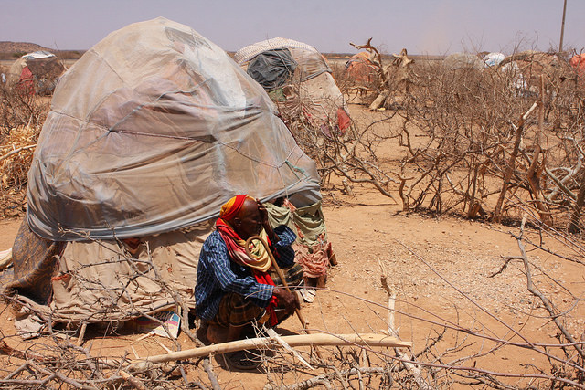 An old man squatting outside his shelter in an IDP settlement in the region around Gode. Credit: James Jeffrey/IPS