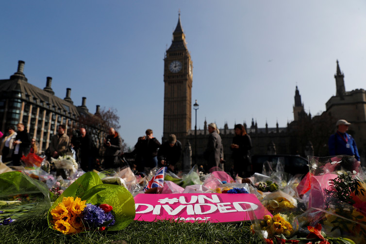 Floral tributes lie in Parliament Square following the March 27 2017 attack in Westminster, central London, Britain. Credit: Stefan Wermuth /Reuters
