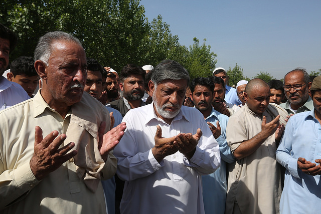 Muhammad Iqbal Khan (left), the father of Mashal Khan, who was murdered by a religious mob in Pakistan. The men offer prayers. Credit: Abdul Hameed Goraya/IPS