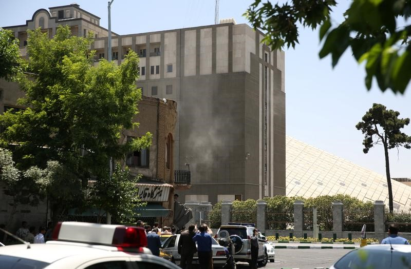 Smoke is seen during a gunmen attack at the parliament's building in central Tehran, Iran, June 7, 2017. Credit: TIMA via Reuters